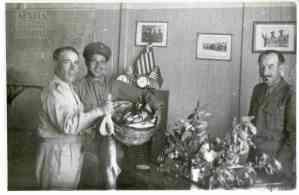 Vasilopoulos inspecting a basket of fish for Bairaktaris