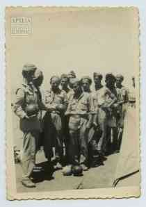 Distributing watermelons at the Second Battalion